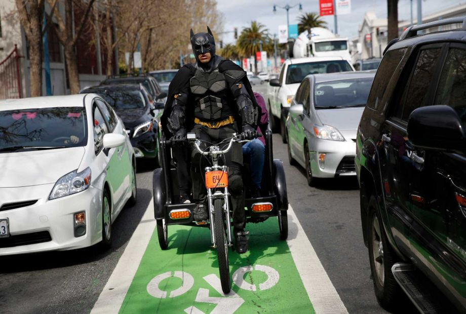 SF Chronicle unmasks Batman as a Golden Gate Pedicab Driver!